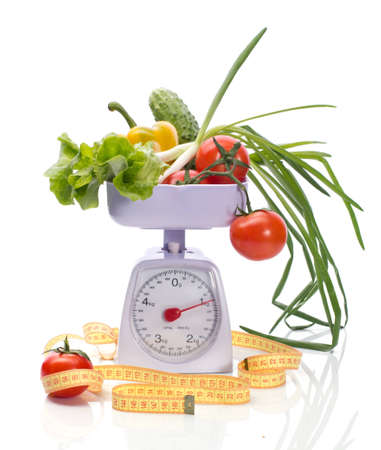 Healthy food on weights and measuring tape isolated on white