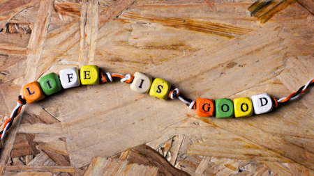 armlet: positive armlet with caption life is good on wooden background