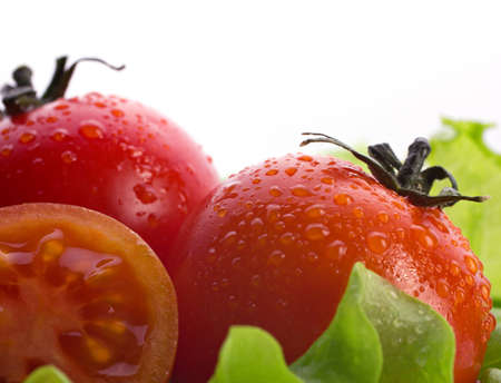 tomatos: red tomatoes and salad, closeup view