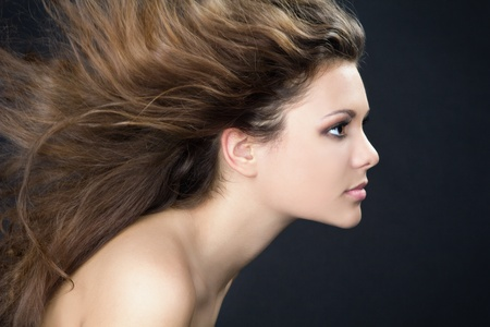 flying woman: A portrait of a beautiful girl with flying hair Stock Photo