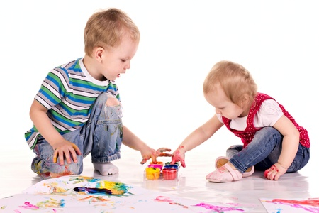 little children are drawing pictures isolated on  white