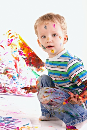 beautiful kid is drawing a picture isolated on white
