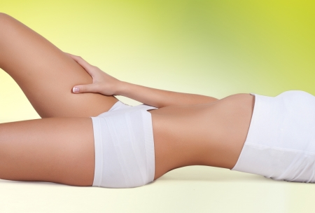 perfect womans body on green background