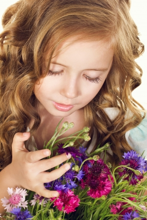 little girl holding field flowers, portrait photo
