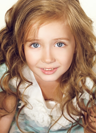 little girl surprised: portrait of a beautiful little girl with blue eyes Stock Photo