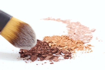 makeup brush and multicolored eyeshadow on white background photo