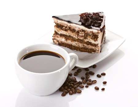 cup of coffee and delicious cake on white background