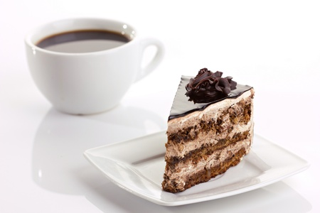 coffee and cake: chocolate cake and coffee cup on white background