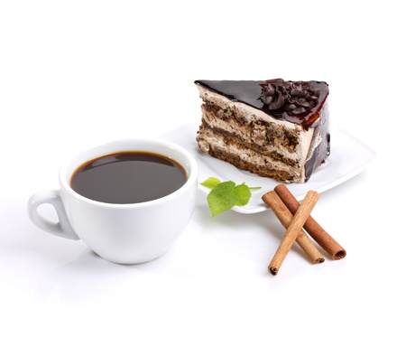 coffee and cake: still-life composed of chocolate cake, coffee and delicate green on white background