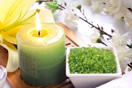spa accessories: candles, sea salt and flowers