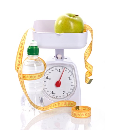 weight-scales, measure, apple and bottle with aqua on a white background photo