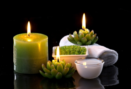 closeup view of candles and spa cosmetics photo
