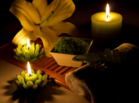 spa still-life with candles, cosmetics, flowers photo