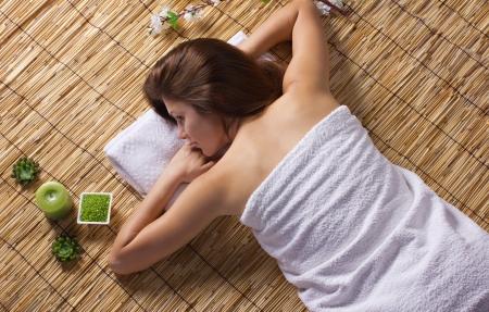 wellfare: beautiful woman relaxing in spa salon Stock Photo