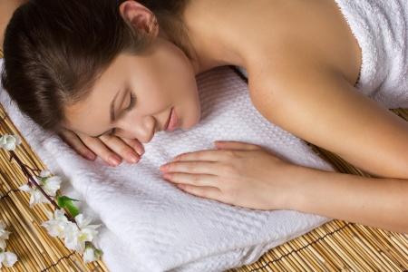 wellfare: portrait of a beautiful woman relaxing in spa salon Stock Photo