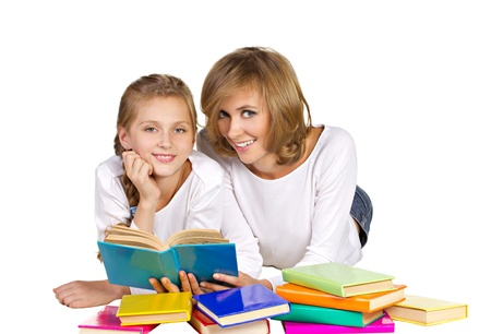 mother and daughter reading books isolated on white photo