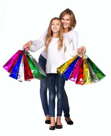 recreate: mother and daughter in white shirt  and jeans  with many colorful boxs isolated on white