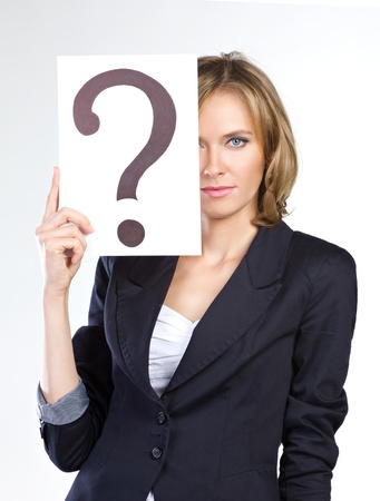 portrait of a business woman holding question mark Stock Photo - 15489721
