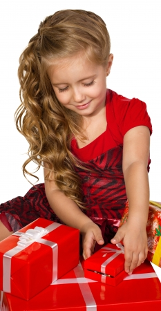 elation: beautiful  little girl sitting and  lookingl  presents in a box set isolated on white