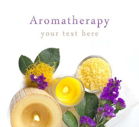 bath salts: aromatherapy with violet, candles and bath salts isolated on white