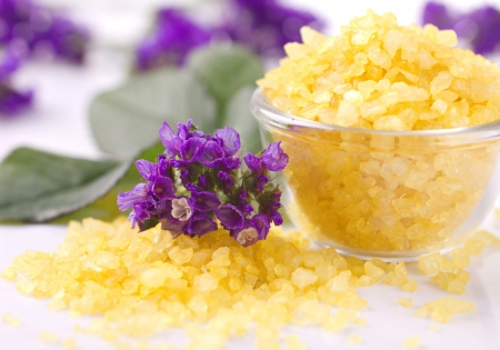 violetes and  bath salts on white at unfocused background Stock Photo