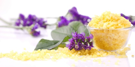salts: aromatherapy with violet and bath salts on white background