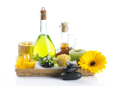Spa  still life with bottles, flowers, stone, towel isolated on white  Stock Photo