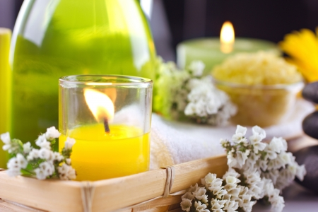 white candle: Spa  lifestill  with flower  and candles on dark and unfocused  background Stock Photo