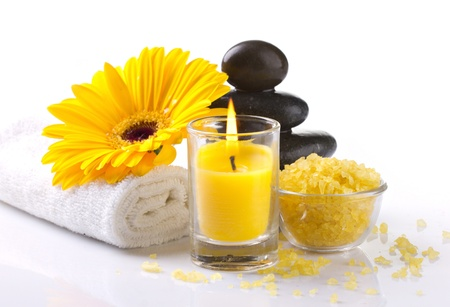 body spa: spa accessories, yellow flower and candles on white background