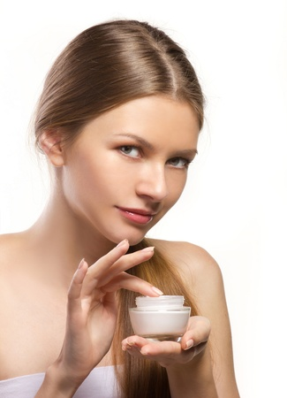 young women applying cosmetic cream isolated on wthite