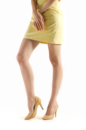 beautiful long legs in models footwear and hands of young women  isolated on wthite photo