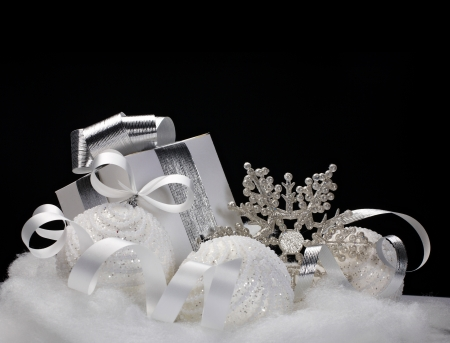 White Christmas balls, gift, snowflake - still life on black background photo