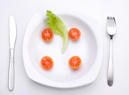 healthing food on plate,  fork and knife on  light background Stock Photo - 17216067