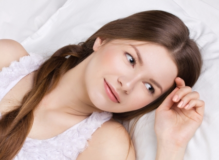 beautiful  young woman asleeping in a white bedding Stock Photo - 17230315