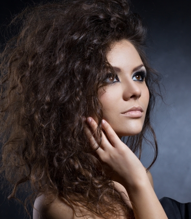 attractive gorgeous: close up portrait of a beautiful girl on dark background