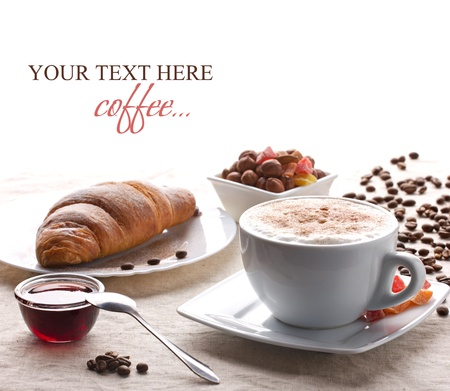 breakfast with coffee, croissant, nut and jam on white tablecloth on white background Standard-Bild
