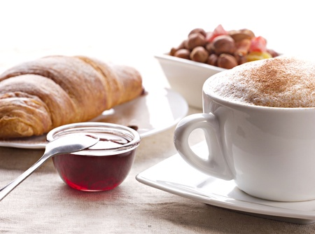 candied: coffee with cream and cinnamon, croissant, jam, nut and candied fruits