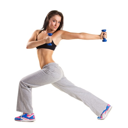 young dancer: young  woman  training with dumbbels isolated on white Stock Photo