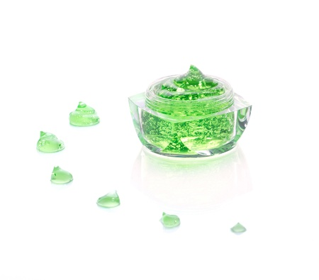 oxygen cosmetics gel in glass jar and gel drop isolated on white