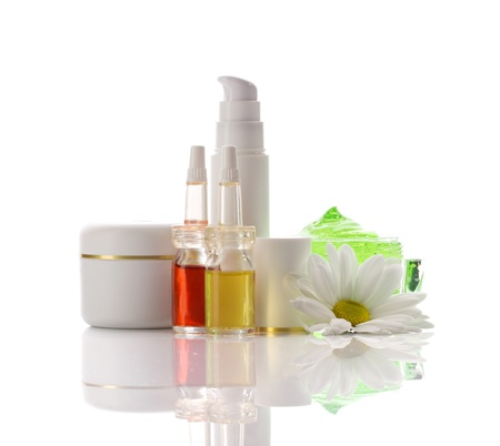 cosmetics collection: cosmetics collection - cream, serum, oil, gel and chamomile isolated on white
