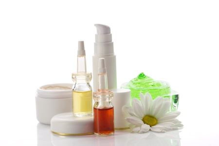 cosmetics collection: medical cosmetics products and chamomile isolated on white Stock Photo