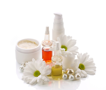 natural cosmetics products with pearls and chamomile isolated on white