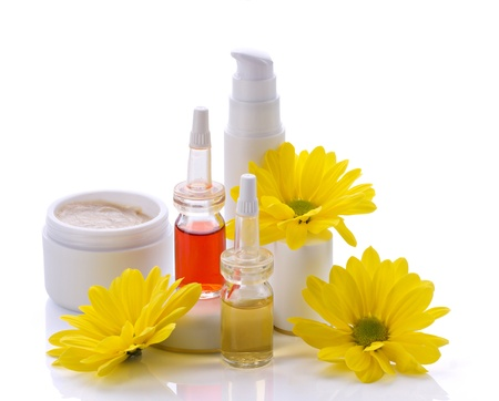 natural cosmetics products and  yellow flowers isolated on white