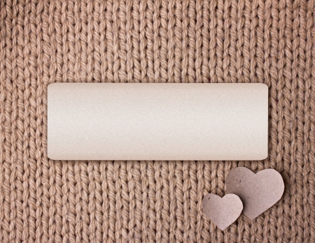background of beige wool texture and two cardboard  hearts for your text hear photo