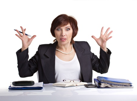 mature business woman with pen and paper in stress Standard-Bild