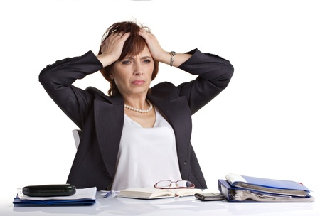 senior businesswoman tear hair, sitting on a table with notebooks and glasses isolated on white