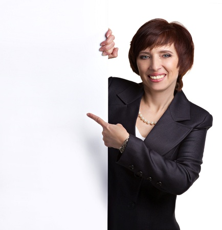 senior business: senior smiling business lady showing sign-board Stock Photo