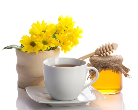 yellow tea pot: tea in teacup,  honey in pot, flower in wood jar isolated on white Stock Photo