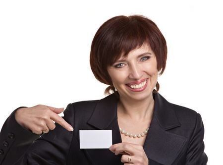 midle-aged business woman showing card on white background photo