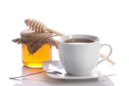 still life - tea with honey isolated on white photo